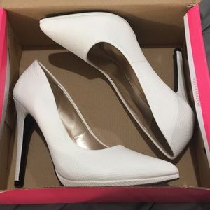 White heels, never worn.